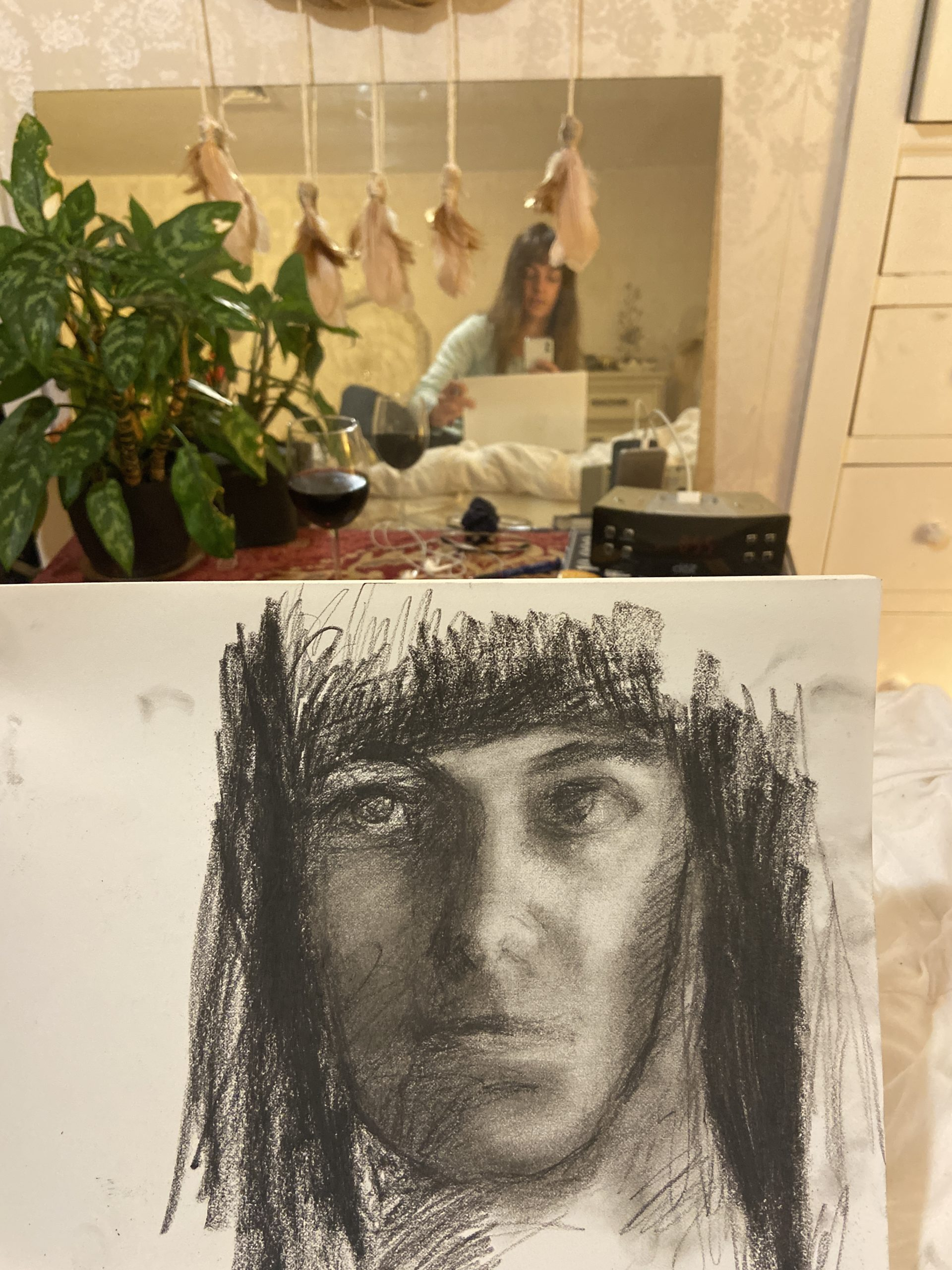 selfie with a self portrait drawing